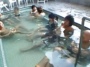 Amateur in a public hottub and surrounded by horny men