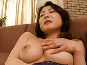 Mai Kozakura teases her nipples as she masturbates in this video