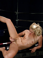 18 year old blond, tanned newbie squirts with machine cock deep in her pussy. She cums multiple times all over her legs and the machines.