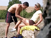 A horny teenage couple fucking on the rocks