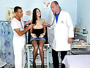 Doctors examining a moist vagina with cocks