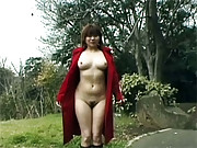 Daring asian girl takes off her long red coat
