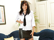 Horny cougar plays with her pussy while wearing stockings and heels