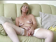 Jill lubes her huge toy before fucking herself