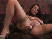 Stockinged MILF plays with her little pink friend