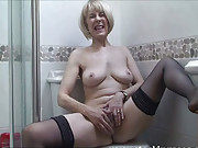 Sexy MILF Hazel strips off in the bathroom before taking a seat on the toilet and rubbing her pussy