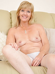 MILF strips off on the couch
