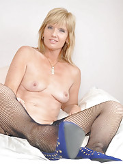 Stunning Jill strips off everything except her black fishnets