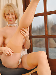 Sexy MILF teases as she straddles a chair