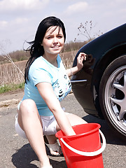 Busty teen washes her car and soaps up her massive tits