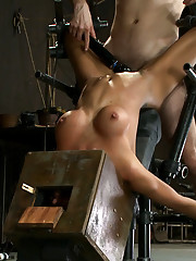 Hot skinny MILF with big tits, is bound in a custom metal device.  She is made to squirt, is fucked, and zippered.  Heavy nipple torture & foot pain.
