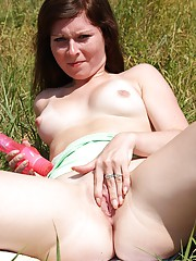 Teenager stroking her moist clit with a dildo