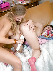 Two adorable teenage lesbians licking pussies