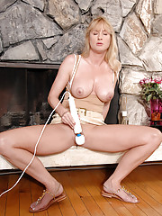 Bethany Sweet shows some up skirt views of her hairy pussy before teasing it with a magic wand