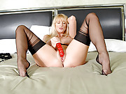 Sexy blonde housewife slips off her lingerie and fucks her dildo