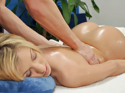 Sexy 18 year old blonde gives a sexy massage with a sexy surprise fuck!