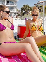 Hot sexy milfs taning at the beach they go home to grab something to eat and they end up eating each others juicy pussy see them fuck one each other with big dildos and strap ons