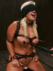 Kait Snow and her big beautiful ass and tits are chained down on the Sybian for some severe punishment and orgasms.