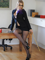 Miss Elise?s promotion is official and she is now Deputy Headmistress. She has taken this promotion very seriously and will be using it to try and increase discipline. You can see her fondling her cane as she strips off her tight little suit revealing her