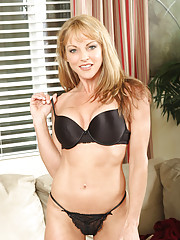 Hot cougar Shayla Laveaux strips off her black bra and flaunts her sexy round ass