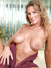Seductive Anilos Jade gets wet in the tub and fondles her pink juice box
