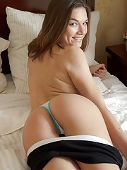 Horny girl using a tiny vibrator in her bed