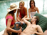 Three clothed hotties jerk off a naked stud by the pool