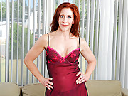 Milf Catherine Desade takes off her lingerie and masturbates