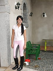 Horny teen beauty masturbates in the stables