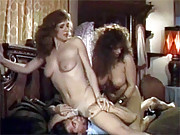 Two horny retro chicks sucking one stiff cock
