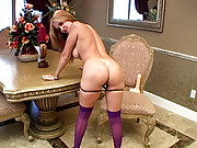 Rio stripping in her purple stockings and getting a load of cum shot in her face