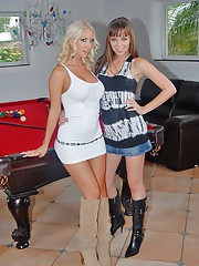 Watch these hot big tits long leg undie lesbians play and strap on fuck on the pool table
