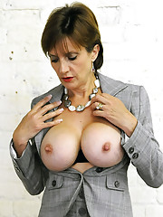 Busty mature in business suit