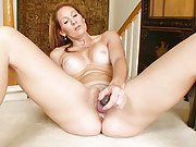 Anilos Crystal plunges a vibe deep in her fuzzy pussy