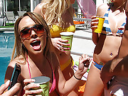Crazy and drunk girls having fun with a stripper by the pool