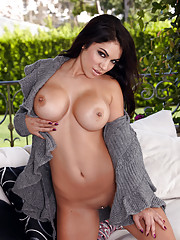 Danni Kalifornia peels off her thong and touches her smooth cooch to please herself.