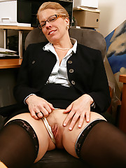Horny mature office chick can\'t wait to show you what\'s in her panties