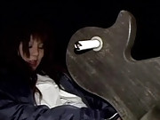 Asian chick masturbating on a big wooden duck