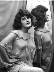 Naked ladies looking in a mirror in thirties