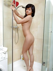 Teen beauty loves showering with a big dildo