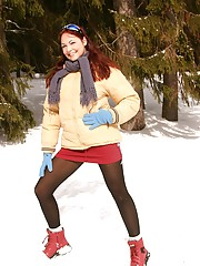 Girl masturbates in the cold snow with finger