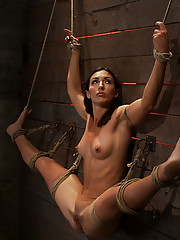 Former gymnast, fitness model has her flexibility put to the test.  Brutal foot caning, nipple torture, and powerful, intense orgasms rule the day.