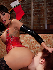 Iona Grace has a kinky lesbian Christmas fantasy with bondage, electricity, and girl on girl fucking