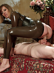 Maitresse Madeline covers slaves cock with a  cock extending cock sheath, fucks it and humiliates him about how he would never feel her pussy.