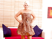 Sassy blonde cougar slowly lifts up her cheetah print gown