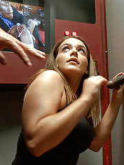 One friends convinces the other to visit a sex store with glory holes.  Both girls go into booths, but there are no locks on these doors.  Sex ensues.