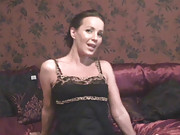MILF performs a sexy little striptease in bed