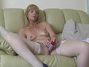 Horny at home housewife plays with herself on the couch