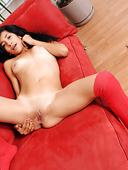 Alluring Nubile Mia Harlow fucks herself on the couch using her rabbit toy