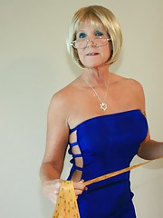 Granny Honey Ray stops by to measure Johnny for a tux when she accidentally touches his cock and give him a free granny handjob at clubtug